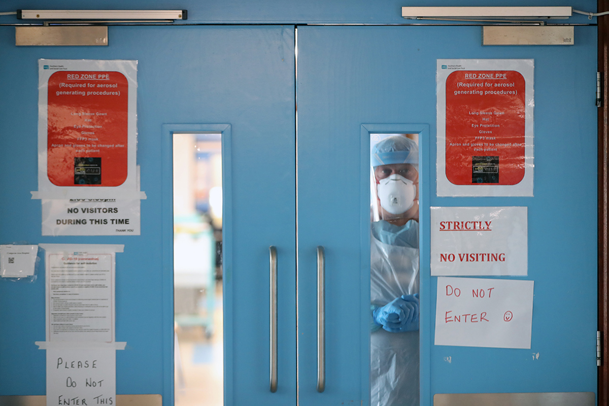 Infection Control nurse Colin Clarke looks out from a Covid-19 recovery ward at Craigavon Area Hospital in Co Armagh, Northern Ireland. (Photo by Niall Carson/PA Images via Getty Images)