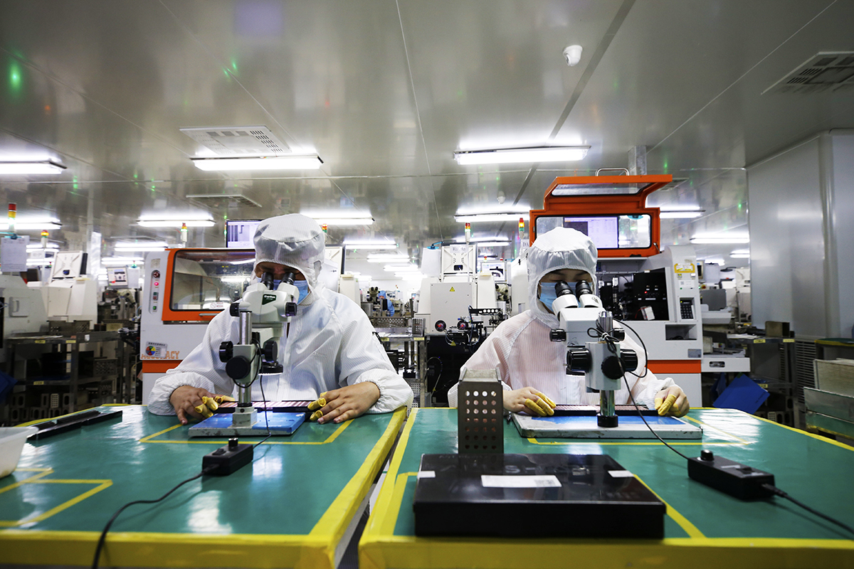 SUQIAN, CHINA - JULY 4, 2021 - A worker works in the workshop of a chip manufacturing enterprise in the Sihong Economic Development Zone in Suqian, Jiangsu Province, China, July 4, 2021.  (Photo credit should read Costfoto/Barcroft Media via Getty Images)