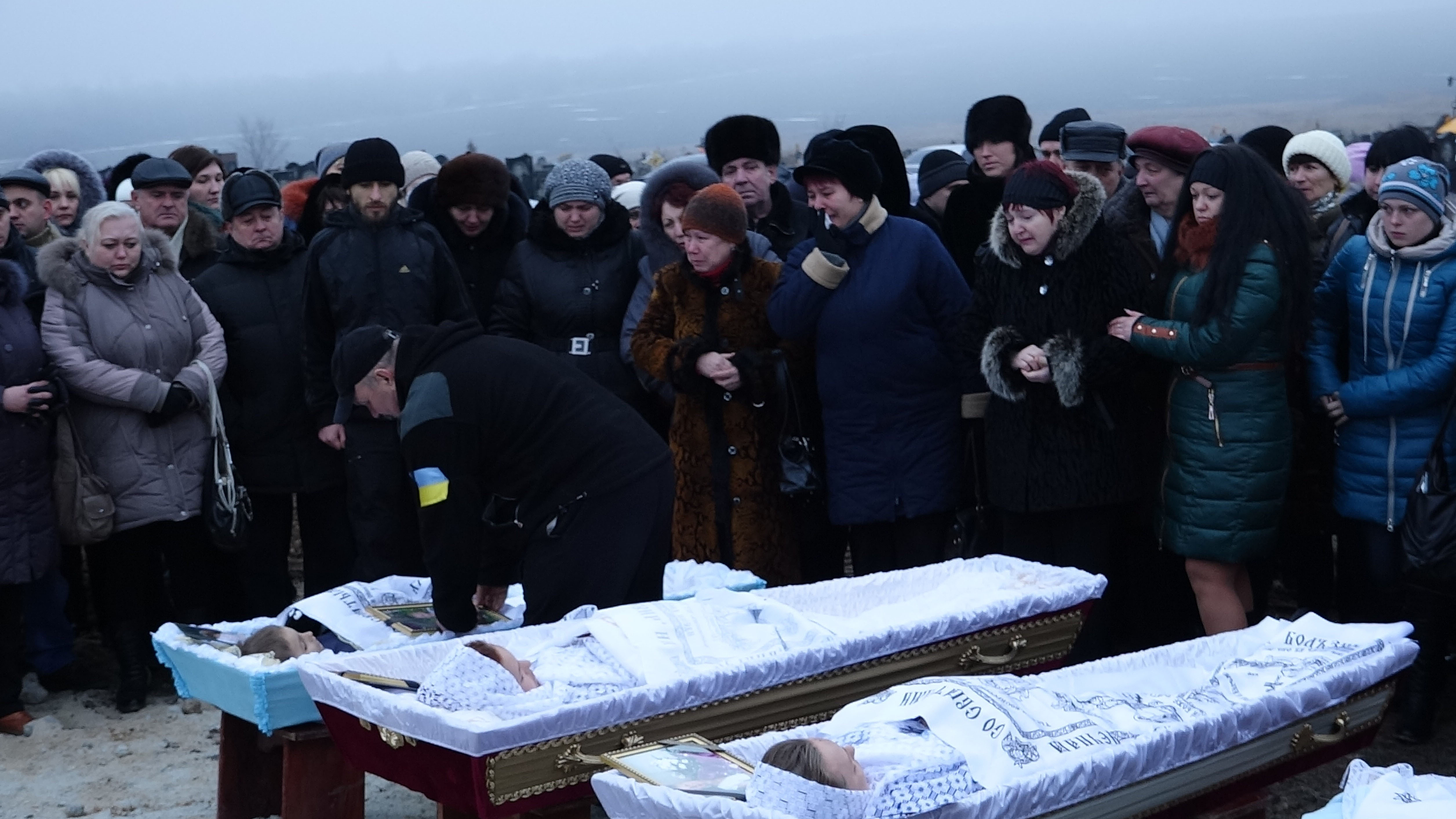 Funeral ceremony after artillery attack on Mariupol in Ukraine