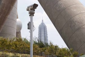 Security CCTV camera at the base of the Oriental Pearl Tower with the Jin Mao Building behind in Shanghai, China. (photo by Mike Kemp/In Pictures via Getty Images Images)
