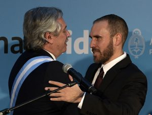 Argentina's new Economy Minister Martin Guzman (R) embraces Argentina's new President Alberto Fernandez after swearing in, at the Casa Rosada presidential palace, in Buenos Aires on December 10, 2019. - Center-leftist Alberto Fernandez vowed to put his people first ahead of debt repayments after he was sworn in as Argentina's president on Tuesday to singing and applause from lawmakers and supporters. (Photo by JUAN MABROMATA / AFP) (Photo by JUAN MABROMATA/AFP via Getty Images)