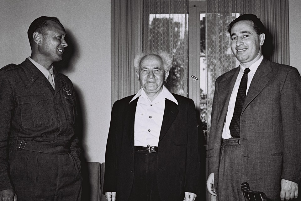 Israel's Defence Minister Ben Gurion stands with Dayan and Director General of the Ministry of Defence Peres in Tel Aviv