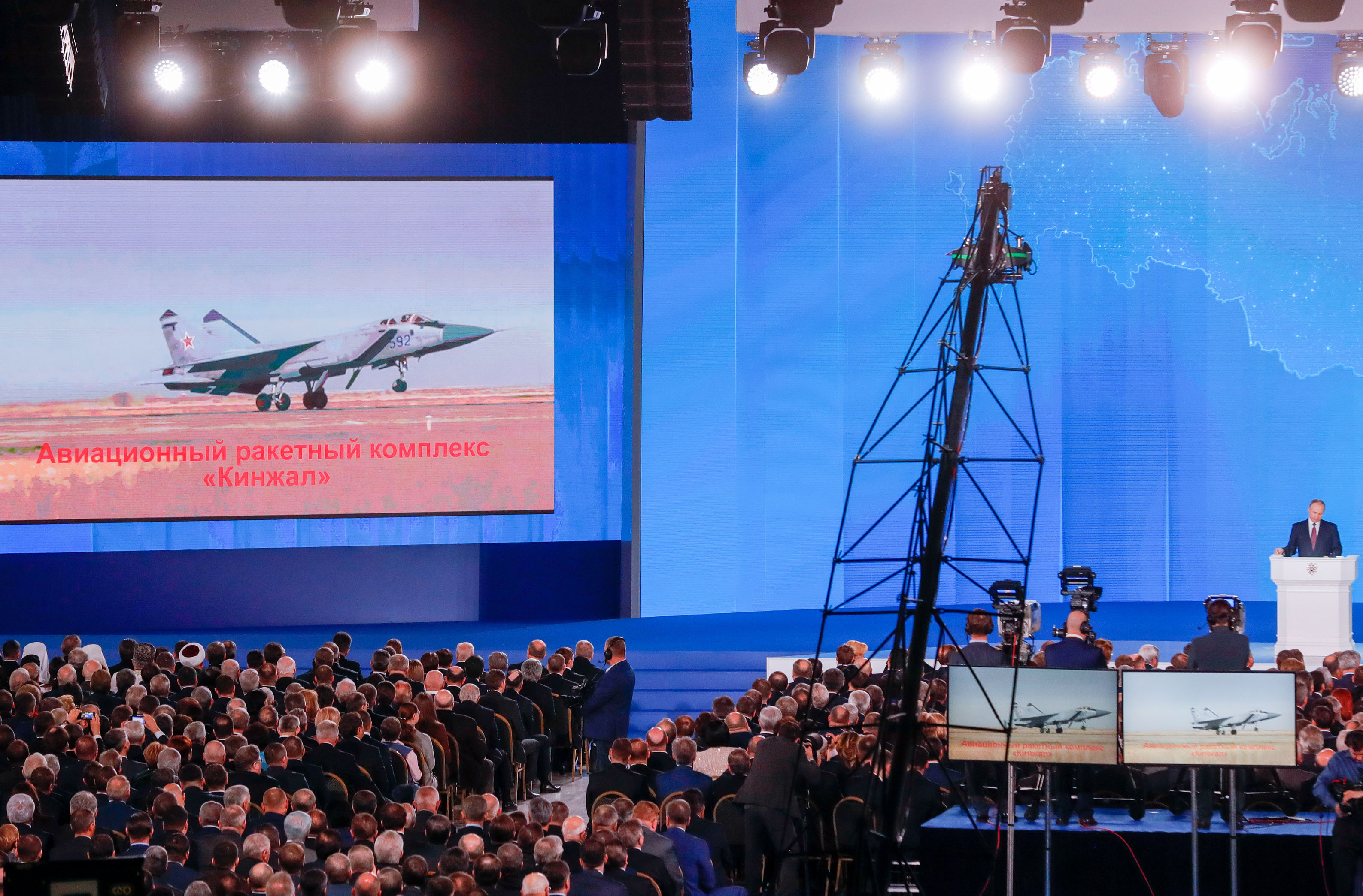 MOSCOW, RUSSIA - MARCH 1, 2018: The video screen shows the Kinzhal air missile system as Russia's President Vladimir Putin (R back standing) delivers an annual address to the Federal Assembly of the Russian Federation, at Moscow's Manezh Central Exhibition Hall; the Federal Assembly of Russia consists of the State Duma of Russia and the Federation Council of Russia. Mikhail Metzel/TASS (Photo by Mikhail MetzelTASS via Getty Images)