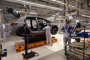 ZWICKAU, GERMANY - NOVEMBER 04: Workers assemble a Volkswagen ID.3 electric car at the Volkswagen factory on November 04, 2019 in Zwickau, Germany. Volkswagen launched assembly of the car at the Zwickau plant today. A spokesman said the numbers of vehicles finished per day will gradually be ramped up, from a current 6 to over 50 by the end of the year, and then much higher numbers in 2020. (Photo by Sean Gallup/Getty Images)